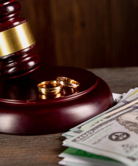 judge's gavel, rings and money